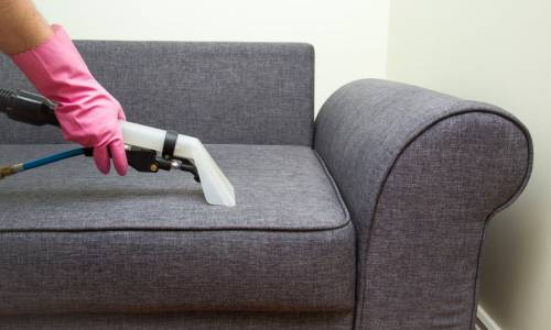 upholstered-furniture-professionally-chemical-cleaning-in-hotel-and-picture-id626851364